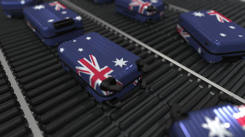 Many travel suitcases featuring flag of Australia. Australian tourism conceptual Footage