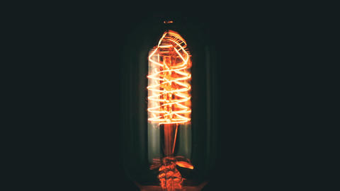 turn on and turn off in slow motion, retro vintage light bulb with old Footage