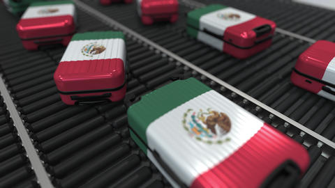 Many travel suitcases featuring flag of Mexico. Mexican tourism conceptual Footage
