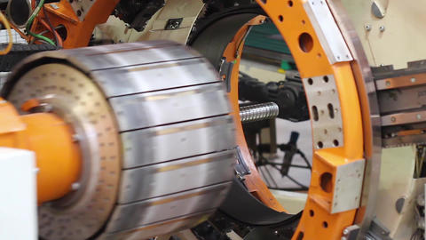 Tire manufacture robotic machine close up Live Action