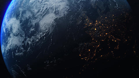 Earth 1028: Planet Earth rotates in space from day into night and city lights turn on Animation