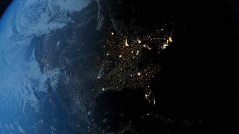 Global 0510: Planet Earth rotates from day into night as city lights turn on in North America Animation