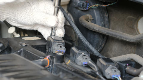 Close up shot mechanic hands are spinning bolt of car to fix and repair the car Footage