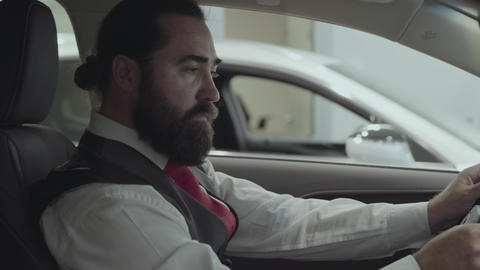Portrait attractive successful bearded businessman sitting in the vehicle and Footage