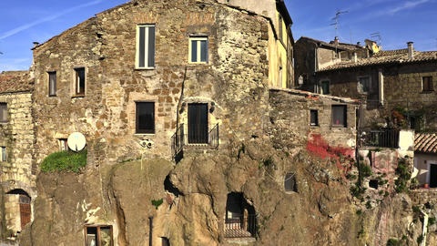 Aerial revealing shot of town of Calcata on high rock. Lazio, Italy Live Action
