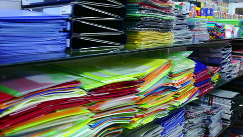 A range of colorful files folders and other school equipment displayed in store. stationery store Live Action