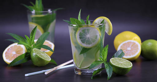 Homemade fresh lemonade with mint in glass on table Footage