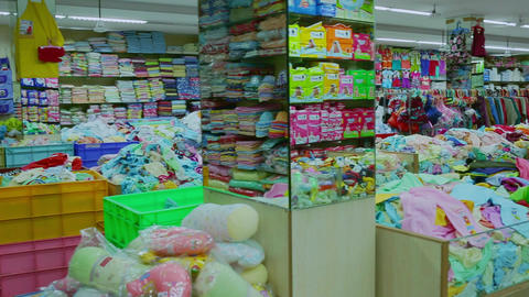 Interior of kids store. Racks with kids clothes in children's clothing store. (Variety of cleaning & Footage