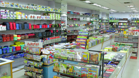 Back to school concept. Purchase of stationery in the store. Close-up. lunch bags, dolly shot Live Action