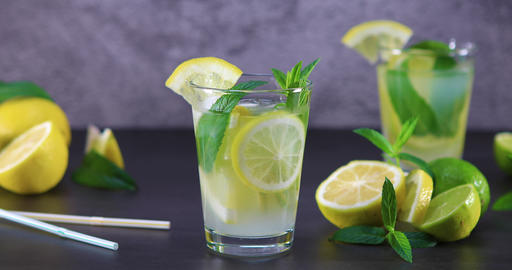 Cold refreshing summer lemonade with mint in a glass Footage