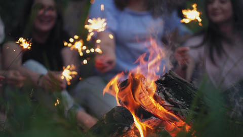 Friends relax in nature around the campfire Footage