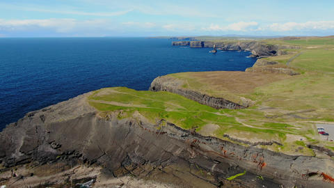 Flight over the Cliffs of Kilkee at the Atlantic coast of Ireland Live Action