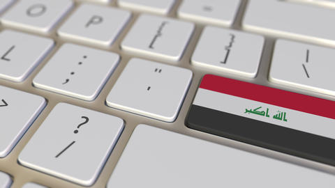 Key with flag of Iraq on the keyboard switches to key with flag of Germany Footage