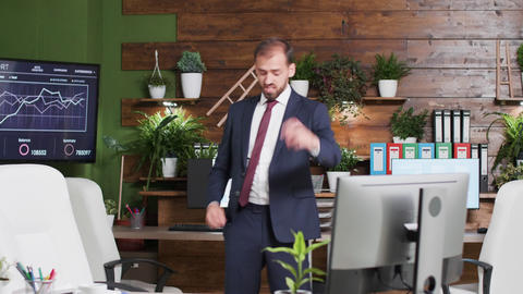 Happy corporate worker dances alone in the office Footage