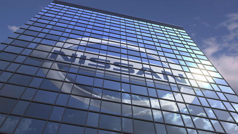 Logo of NISSAN on a media facade with reflecting cloudy sky, editorial animation Live Action
