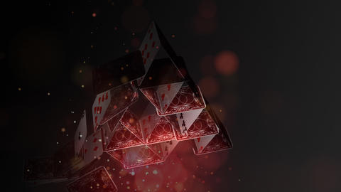 Card pyramid collapsing on a dark background with lights animation Animation