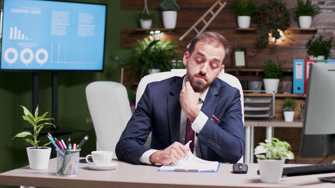 Tired businessman working week ends alone in the office Footage
