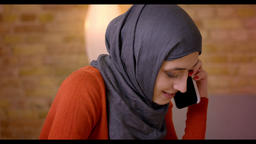 Closeup shoot of young attractive muslim female employee in hijab casually Footage