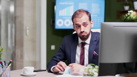 Slow motion shot of overworked businessman alone at office in week end Footage