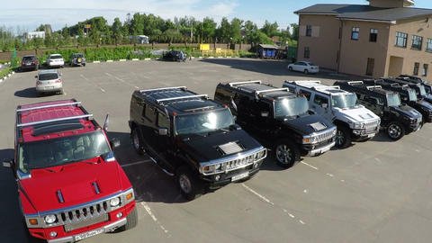Flying over the row of Hummer cars on parking lot Footage