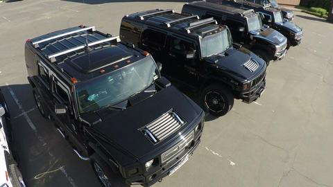 Hummer vehicles on parking lot, aerial view Live Action