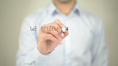 We Believe In Making A Difference , man writing on transparent screen Footage