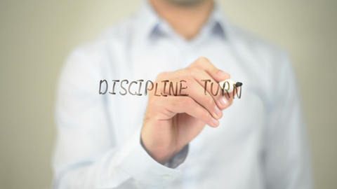Discipline Turns Ability into Achievement, man writing on transparent screen Footage