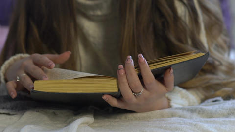 Young Woman Girl Reading Book On Bed At Home Lifestyle Live Action