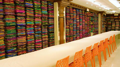 Shop of women's clothing. Sari Shop. Indian Traditional Women's Sari clothing on Market. Dolly Footage