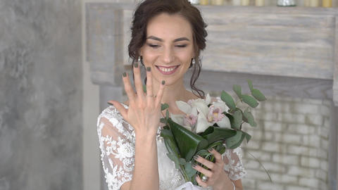 Portrait Of Beautiful Bride Wearing Classic White Dress Shows The Ring Footage