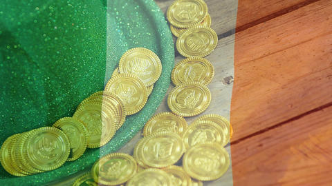 Gold coins and green hat on a table with an Irish flag on the foreground Animation