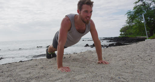 Push-ups - man fitness exercising pushups on beach living healthy lifestyle Live Action