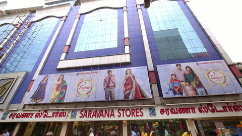 Saravana stores building exterior, A morning exterior establishing shot. people moving busy street Live Action