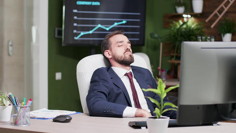 Tired businessman fell asleep at his workplace Live Action