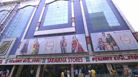 Saravana stores building exterior, A morning exterior establishing shot. people moving Live Action