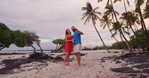 Selfie couple on Hawaii beach vacation with palm trees in Big island Footage