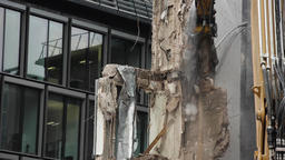 High Reach Excavator Shears Demolishing Wall Remnants Footage