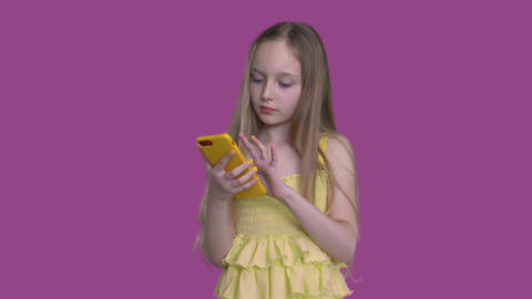 Little Caucasian Girl Looking in Mobile Phone Footage