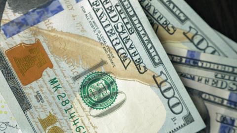 One hundred dollar bills chaotically fall. Closeup shot Footage