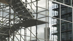Scaffold and Staircase on Glass Office Building Facade Footage