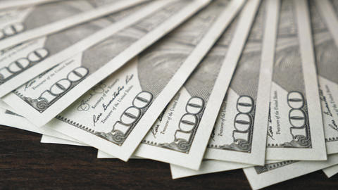 One hundred dollar bills rotate smoothly Footage