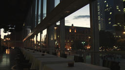 High-End Restaurant Tables with City Street View at Dusk Live Action