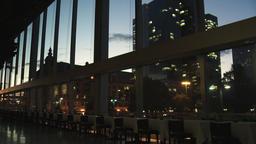 City Buildings through Restaurant Window at Twilight Footage