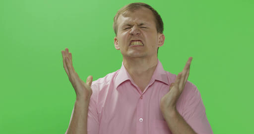 Angry aggressive young man in shirt nervous emotions. Chroma key Live Action