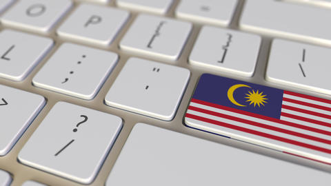 Key with flag of Malaysia on the keyboard switches to key with flag of France Live Action