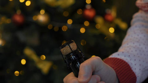 Real Time Man Opening Champagne Bottle During Christmas Time Footage