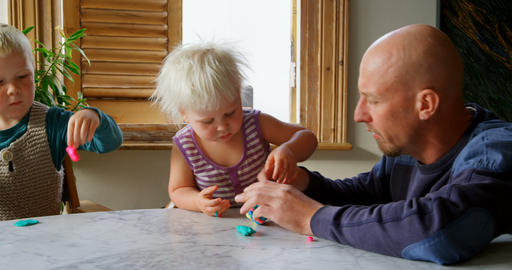 Father and children playing together with clay in a comfortable home 4k Live Action