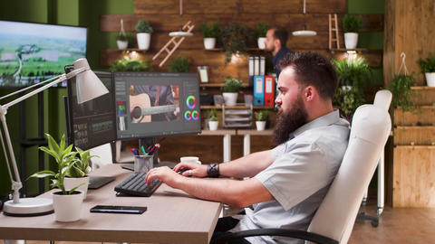 Male editor working in post production studio Live Action