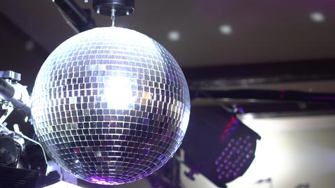 Slow Motion Disco Ball With Light Flare Footage
