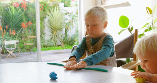 Kids playing with clay in a comfortable home 4k Live Action